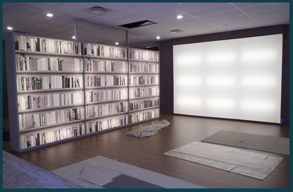 Light box wall and lighted shelving floating walls in a vendor's showroom.