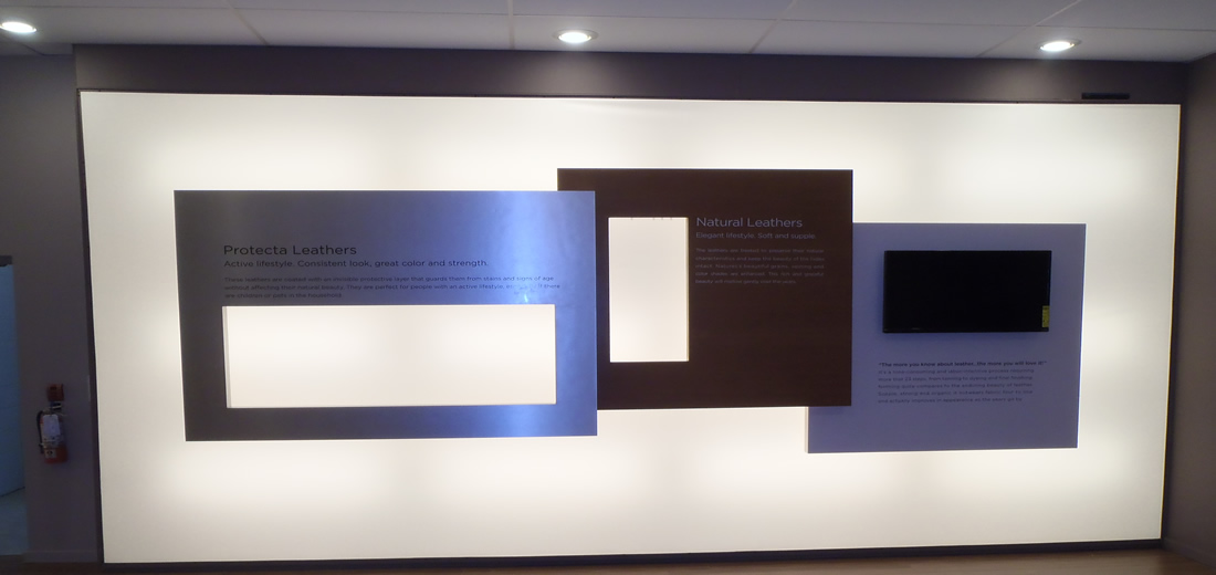 Product endorsement and information on lightbox wall.