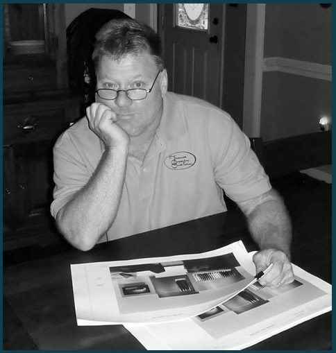 Thomas Jones, owner, reviewing details of showroom planning.